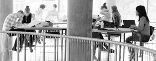 Students sitting at desks, working at Campus