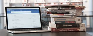 Laptop and books - new Libsearch