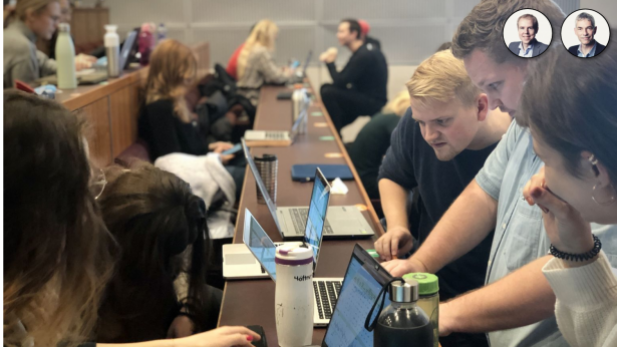 CBS students work on computers to solve business simulation game